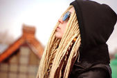 Young beautiful blonde with dreadlocks in sun glasses and hood — Stock Photo
