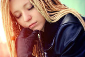 Young beautiful blonde with dreadlocks and pirsing — Stock Photo