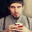 Englishman with a cup — Stock Photo