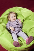 Baby in smooth chair — Stock Photo