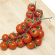 Cherry tomatoes on a board — Stock Photo