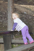 Baby girl in a park — Stock Photo