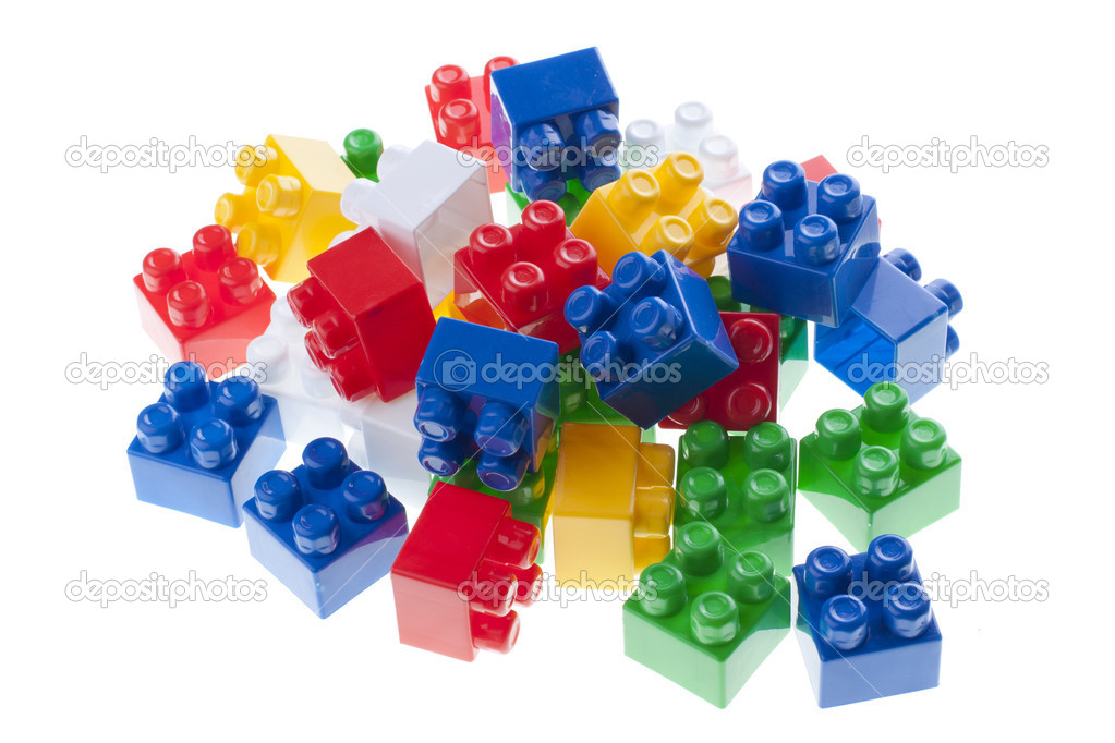 Plastic constructor bricks heap. isolated on white. — Stock Photo #10498785