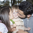 Happy family in a park — Stock Photo #10544458