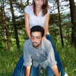 Couple playing in park — Stock Photo