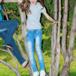 Girl on a tree — Stock Photo
