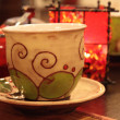 Handpainted tea cup — Stock Photo