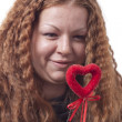 Redhead girl's holding heart — Stock Photo