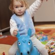 Baby riding a toy horse — Stock Photo