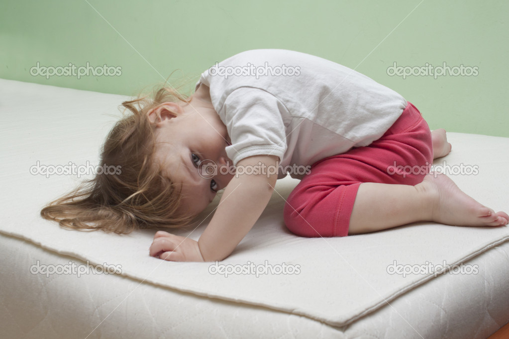 Baby practice yoga on bed  Stock Photo #9757276