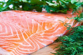 Fresh salmon with herbs — Stock Photo