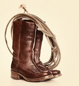 Brown cowboy boots and a Lasso — Stock Photo