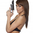 Beautiful young woman holding pistol gun — Stock Photo