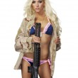 Sexy blond woman isolated holding army weapon — Stock Photo