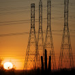 Power lines at sunset in AZ desert - Stock Photo