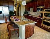 Kitchen with granite island counter — Stock Photo