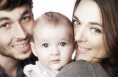 Happy family, mother, father and baby daughter — Stock Photo