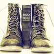 Bible and boots — Stock Photo