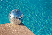 Disco ball beside swimming pool — Stock Photo