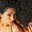 Beautiful woman with curly hair — Stock Photo