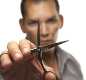 Male hair stylist holding steel cutting scissors — Stock Photo