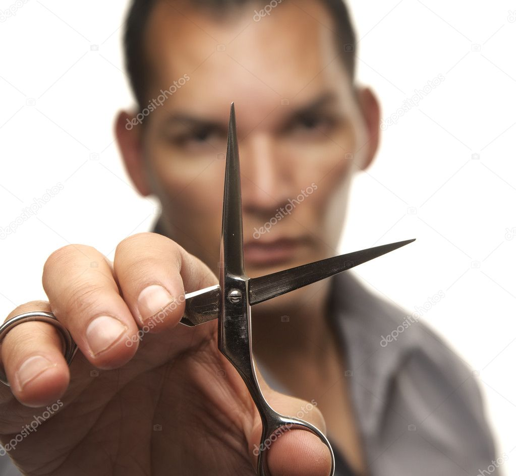 Male hair stylist holding steel cutting scissors isolated on white  Stock Photo #8976418