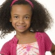 Adorable smiling little girl with curly hair — Stock Photo