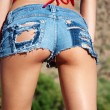 Wet Ripped Tiny Denim Booty shorts — Stock Photo