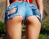 Wet Ripped Tiny Denim Booty shorts — Stock Photo