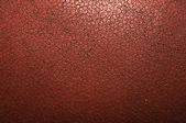 Close-up detail van de textuur van een american football. — Stockfoto