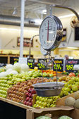Grocery store scale with fruit and veg — Stock Photo
