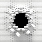 Destruction of a white brick wall — Photo