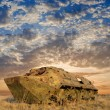 Stock Photo: Damaged carrier in steppe