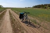 Bicycle on a rural road — Stock Photo