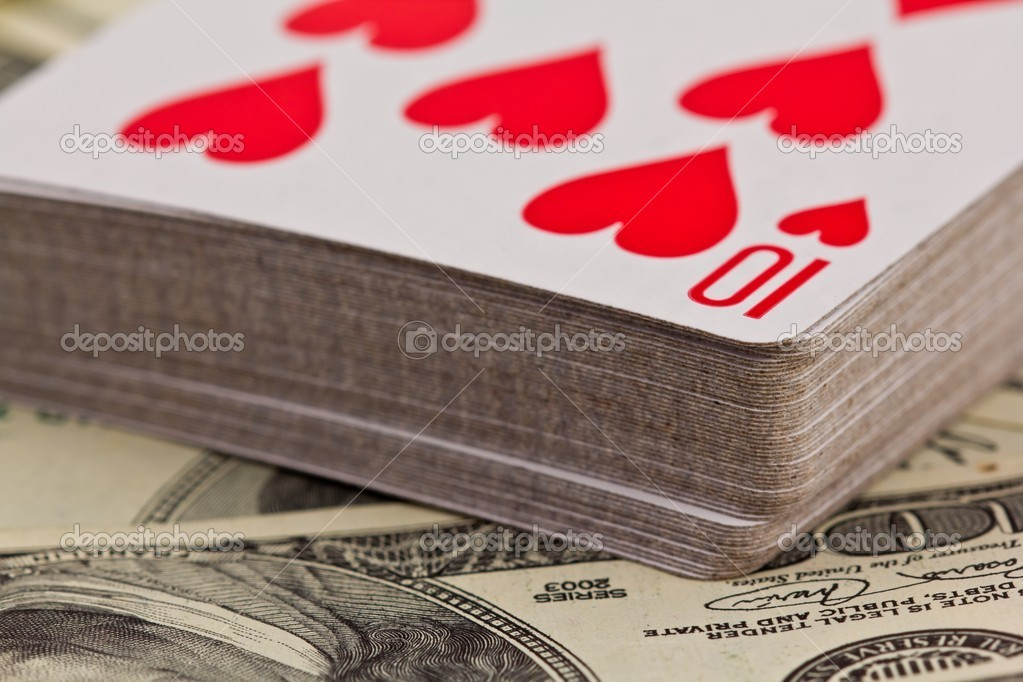 Playing cards on a money background — Stock Photo #10639067