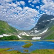 Blue lake near rocky mountains — Stock Photo #7978080