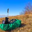 Stock Photo: Touristic rucksack lying in grass