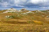 Mountain plateau under a dense clouds — Stock Photo