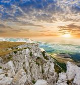 Mountain precipice at the sunset — Stock Photo