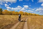 Biker in a steppe — Stock Photo
