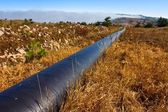 Gas pipe in a steppe — Stock Photo