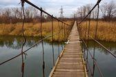 Suspended bridge over a river — Stock Photo