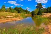 Blue lake in a summer steppe — Stock Photo