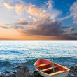 Beautiful oared boat on a sea coast at the evening - Stock Photo