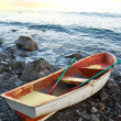 Oared boat on a sea coast by a morning — Stock Photo