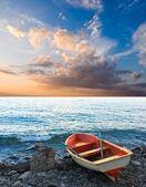 Beautiful oared boat on a sea coast at the evening — Stock Photo