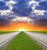 Two way asphalt road at the sunset — Stock Photo