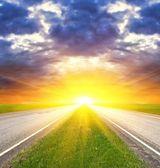 Asphalt road at the sunset — Stock Photo