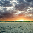 Sunset on a dried-up lake — ストック写真