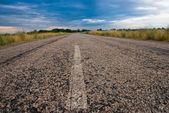 Asphalt road under a dense sky — Stock Photo